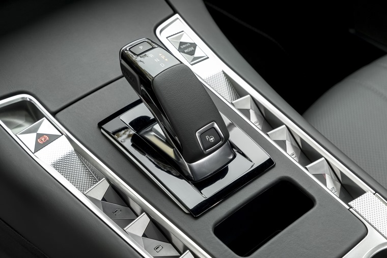 The diamond pattern theme runs throughout the car's design