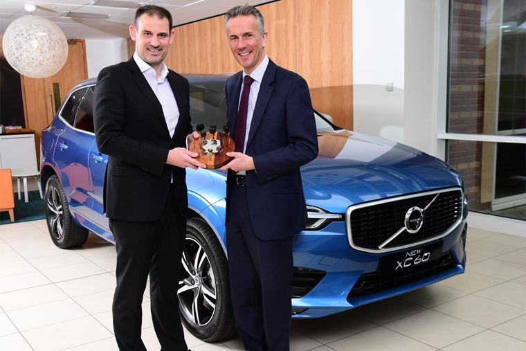 Jon Wakefield, MD of Volvo Car UK, (right) receiving the UK Car of the Year