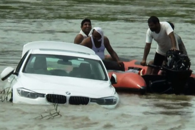 An ungrateful birthday boy pushed his BMW into a river because he wanted a Jaguar