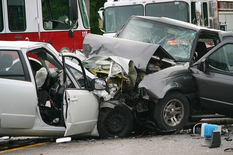 A car and pickup truck are seen after a fatal head-on collision on Hwy.7 near Elm Tree Rd. just west of Lindsay late in the afternoon of Sunday, Aug. 28, 2011.