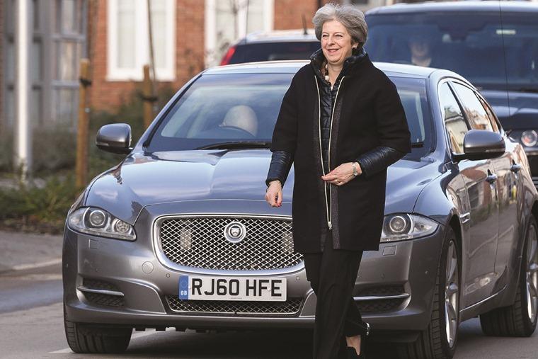 Theresa May with Jaguar (pic source: Car Dealer)