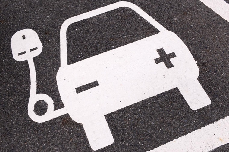 A car parking space marked to indicate electric vehicle charging
