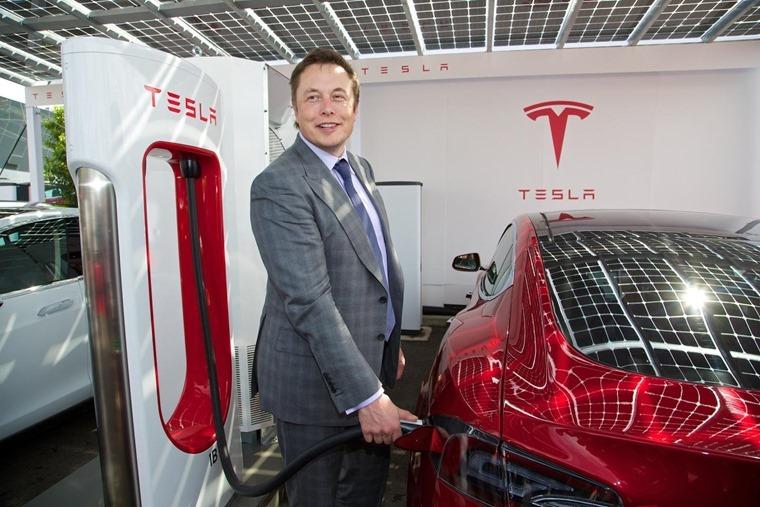 Elon Musk recharging a Model S