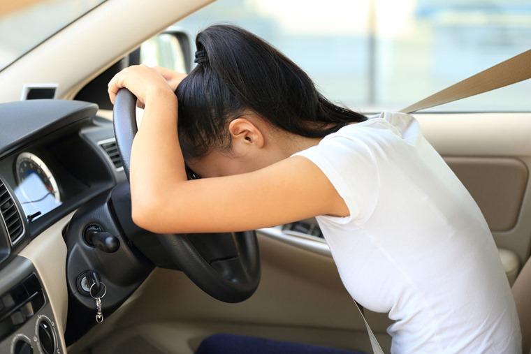 49933044 - sad woman driver in car