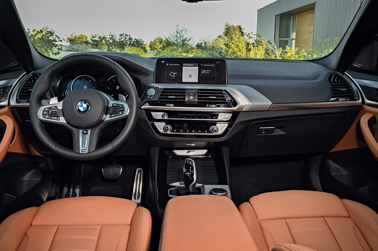 New BMW X3 interior with updated infotainment and fresh dash design.