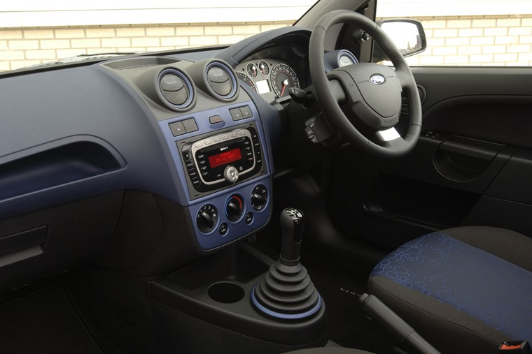 Supermini interiors have come a long way... note lots of buttons and a CD player.