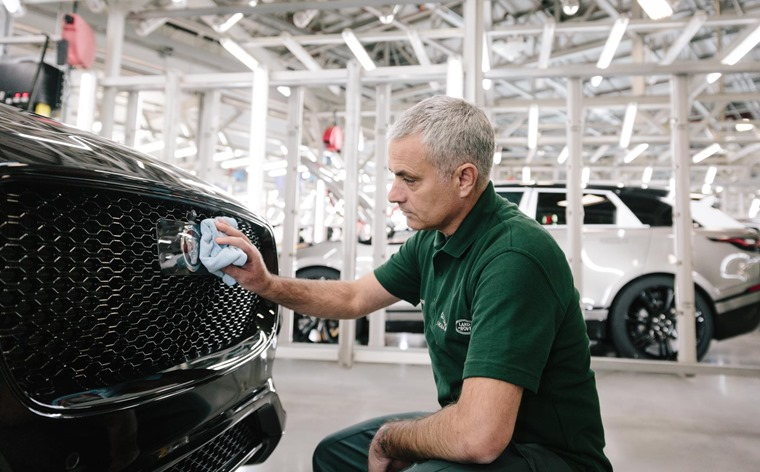 Jose Mourinho buffing the grill of a Jaguar F-Pace