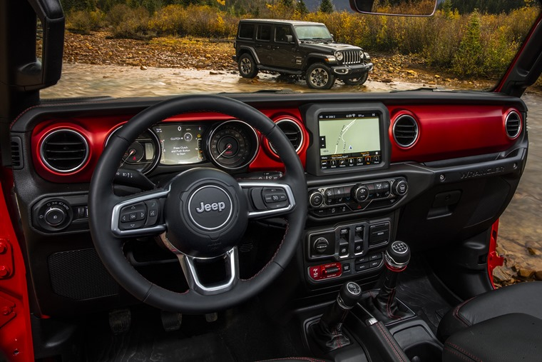 The interior features improved materials and new tech.