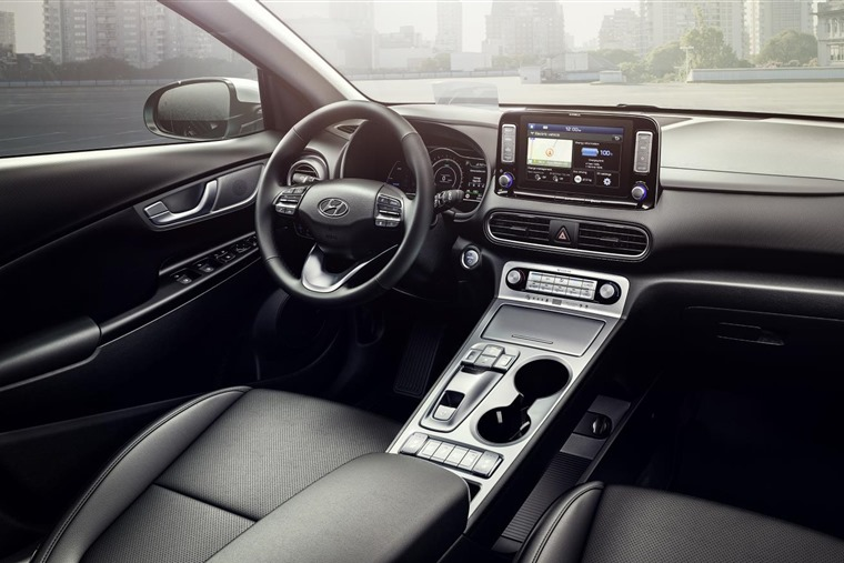 The interior is largely the same as the standard Kona, although the EV controls replace the gear stick.