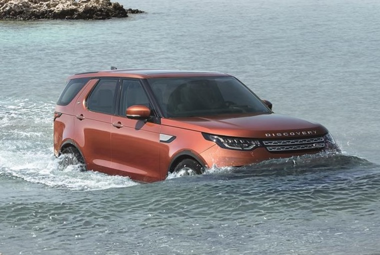 Land Rover Discovery wading in water