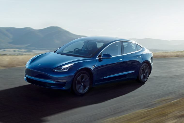 Model 3 Right Hand Drive Blue Driving Front Quarter