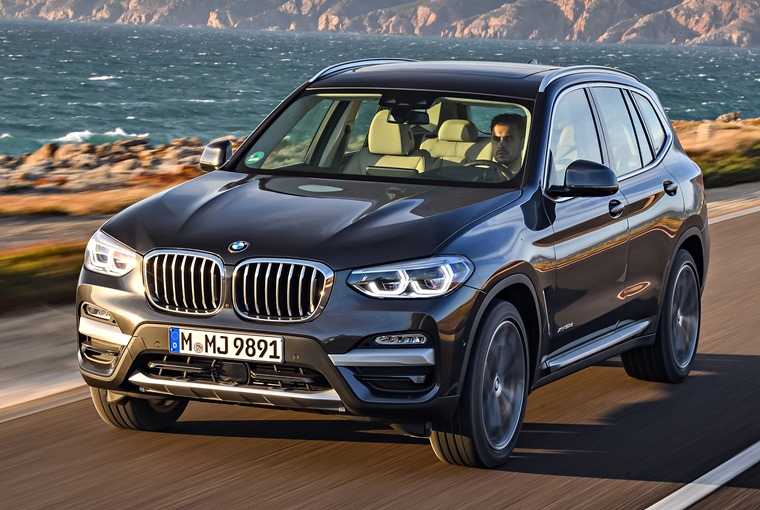 BMW X3 front shot, on the road