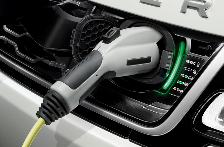 The government has scrapped its plug-in car grant for hybrids and reduced it for all-electric cars.