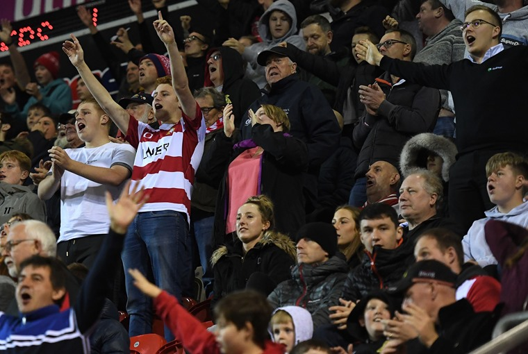 Doncaster Rovers fans celebrate their goal in Leasing.com Trophy. Photo: Anna Gowthorpe/BPI/Shutterstock.