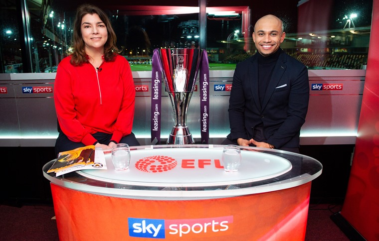 Sky sports presenters in the studio with the Leasing.com trophy