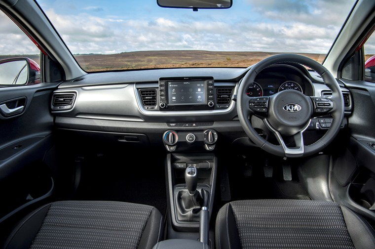 The interior is largely carried over from the smaller Rio hatchback.