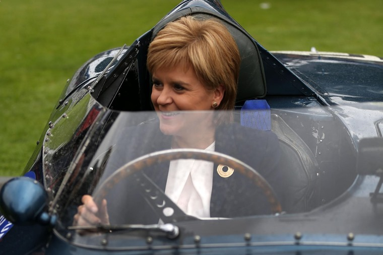 Nicola Sturgeon pictured in a classic car at the Concours d'Elegance, but she's looking to the future rather than the past.