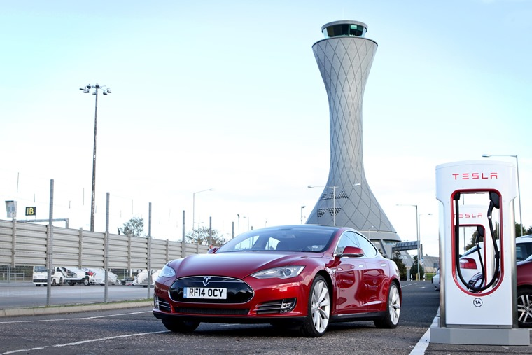 Supercharger and Tesla at Glasgow Airport.
