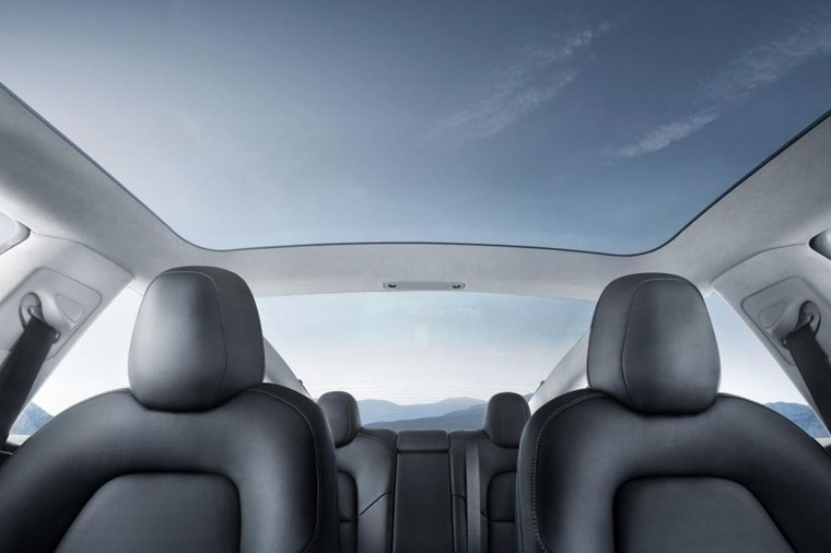 All models are expected to get Tesla's trademark panoramic roof.