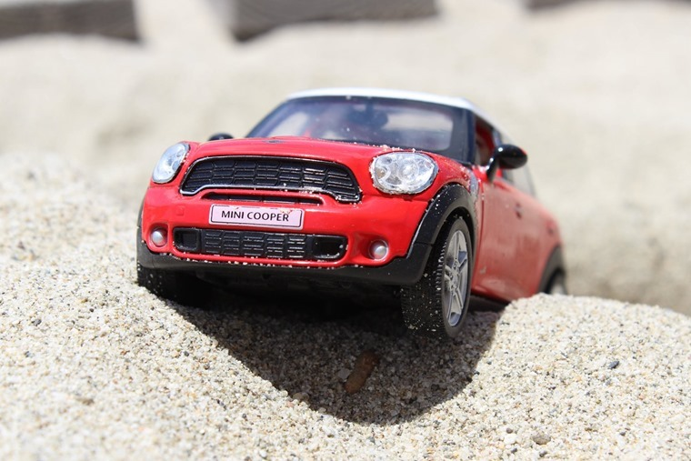 Toy Mini Cooper stuck in sand[9]