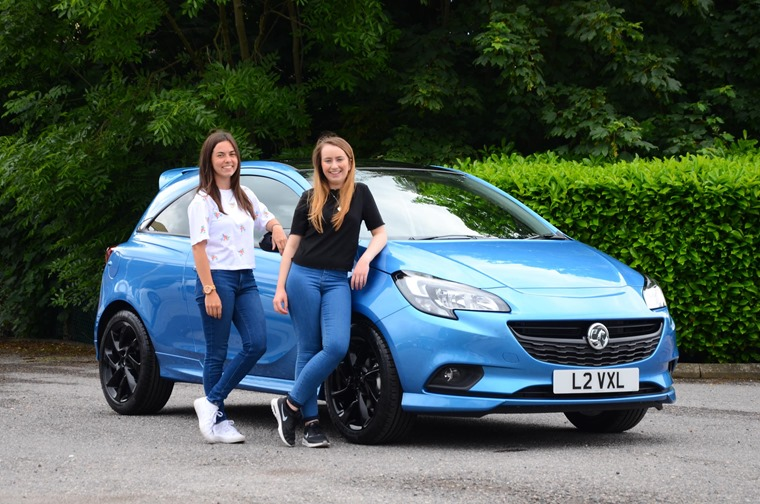 Two young drivers enjoy a grand saving