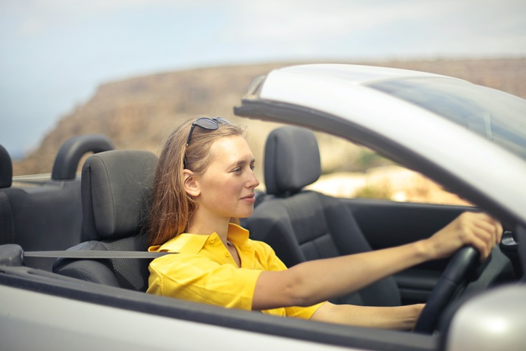 woman-in-yellow-shirt-driving-a-silver-car-787476